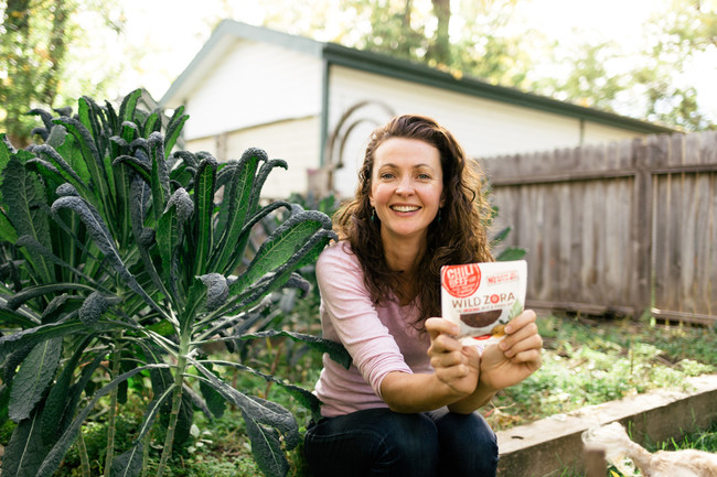 Zora, founder and inventor of the Original Meat and Veggie Bars™, in her home vegetable garden in Fort Collins, Colorado.