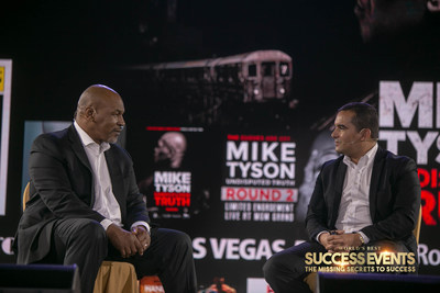 Andres Pira (right) is moderating on stage with World Heavyweight Champion Mike Tyson (left) in the motivational seminar Success Events, in which he founded in 2018.