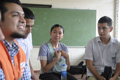 Dancer and choreographer Jess Ortaleza listens as World Vision El Salvador staff translate the stories of a group of high-school students affected by violence during a 2018 trip with Mississauga dance crew Kindred Culture. Photo/World Vision. (CNW Group/World Vision Canada)