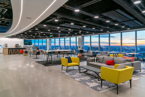 """On the top floor of PTC's new global headquarters, a large collaborative space called """"The Common"""" provides a variety of seating for both employees and customers. A large, open stair with a glass head-house connects The Common to the landscaped roof deck with outdoor seating. Photo credit: Warren Patterson Photography."""