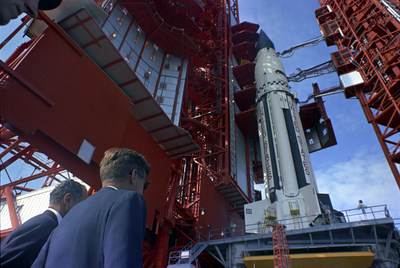 Caption: Senator George Smathers of Florida and President John F. Kennedy at Pad B, Complex 37, Cape Canaveral, Florida, where they were briefed on the Saturn rocket. November 16, 1963. Credit: Cecil Stoughton, White House/John F. Kennedy Presidential Library and Museum