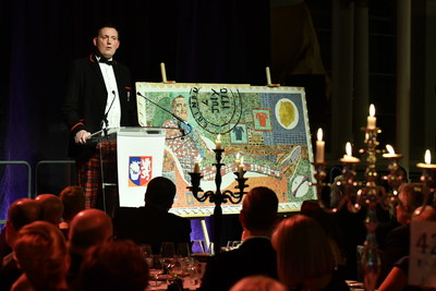 Doddie Weir, OBE, gives an inspiring and emotional speech during the Erskine Stewart's Melville Schools' fundraising 'ESMS Dinner for Doddie' at the National Museum of Scotland where more than £90,000 was raised for My Name'5 Doddie Foundation and Access to Excellence (PRNewsfoto/ESMS)
