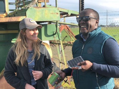 Left, Stephanie Tatge, Ecosystem Services Analyst for The Freshwater Trust and Nathan B Wangusi, Technical Lead for Water Research, IBM Research - Africa, holding a low-cost satellite sensor from SweetSense Inc.