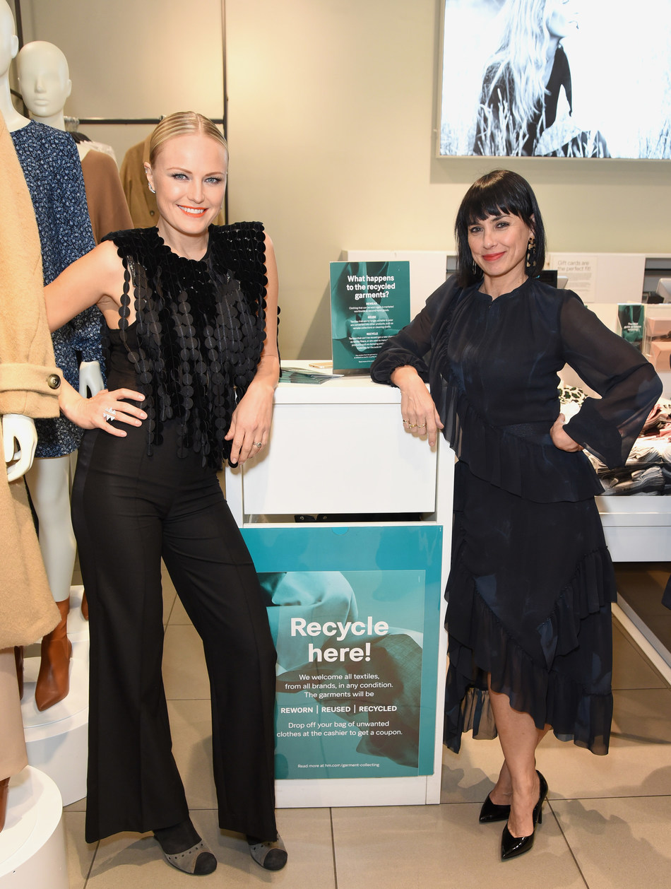 Malin Akerman and Constance Zimmer in front of H&M's in store Garment Collecting Bin.