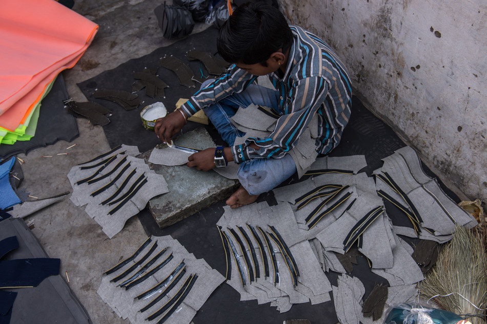 Karan, 12, engaged in child labour in India's footwear industry. Photo/World Vision (CNW Group/World Vision Canada)