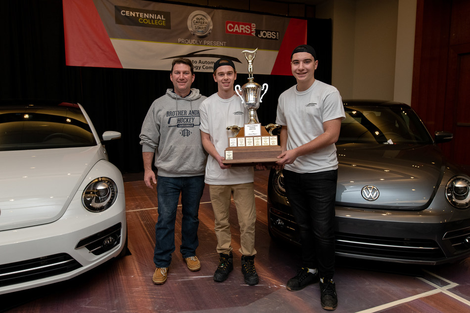 From left: Teacher Jason Rehel and auto tech students Sam Luff and Vince Servinis from St. Brother Andre Catholic High School hoist the trophy at the Toronto Automotive Technology Competition on Feb. 13. (CNW Group/Centennial College)