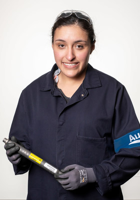 Maria Patino, production associate at Autoliv Brigham City, holds the one billionth airbag inflator produced at the facility. February 14, 2019