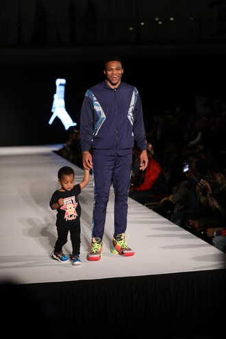 Russel Westbrook and his son Noah walking on the Rookie USA Runway for Jordan Brand.