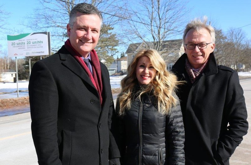 From left to right: The Honourable Heath MacDonald, PEI's Minister of Finance, the Honourable Tina Mundy, PEI's Minister of Family and Human Services, and Sean Casey, Member of Parliament for Charlottetown, stand in front of the future site of a new 20 unit transitional housing building. (CNW Group/Canada Mortgage and Housing Corporation)