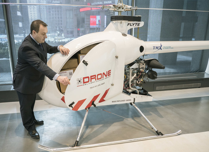 Tony Di Benedetto, CEO of Drone Delivery Canada opens the cargo bay door of his company's newest, largest and farthest range cargo delivery drone, the Condor, in Toronto, Ont. on Tuesday, February 19, 2019.  The 7 metre long Condor has a payload capacity of 180 kilograms and a potential travel distance of up to 200 kilometres.  THE CANADIAN PRESS IMAGES/J.P. Moczulski (CNW Group/Drone Delivery Canada)