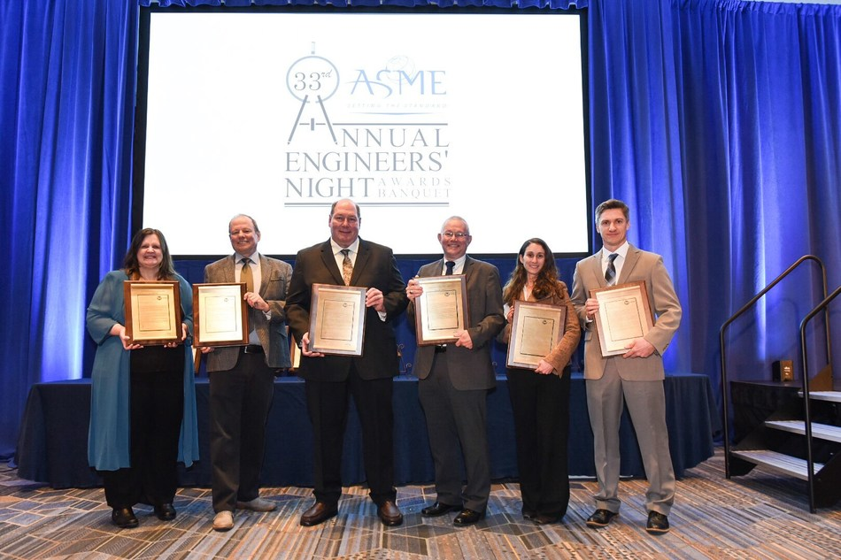 Honored at the ASME Engineers of the Year Awards on February 21, 2019 were (l-r) Pratt & Whitney's Lisa Brasche; Brad Sammann; Jim Becker; Bill Lamberti (VP Engineering Chris Kmetz holding his award); Meggan Harris; and Sean McCutchan.