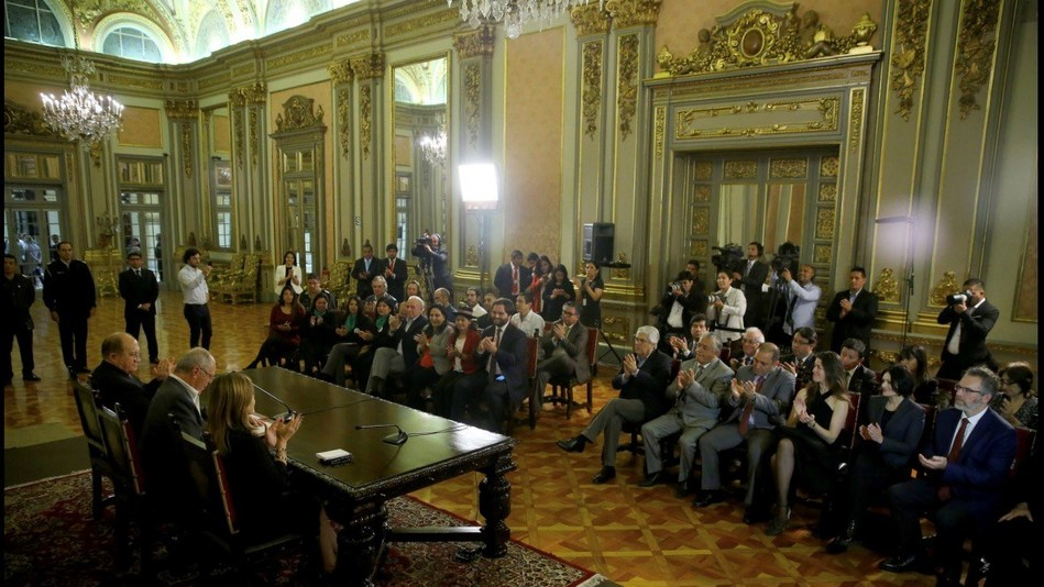 Richard Zwicky CEO of Plena Global Inc and associates present at the Presidential Palace in Lima Peru for the signing of the Act legalizing medical cannabis in November 2017 (front, right).