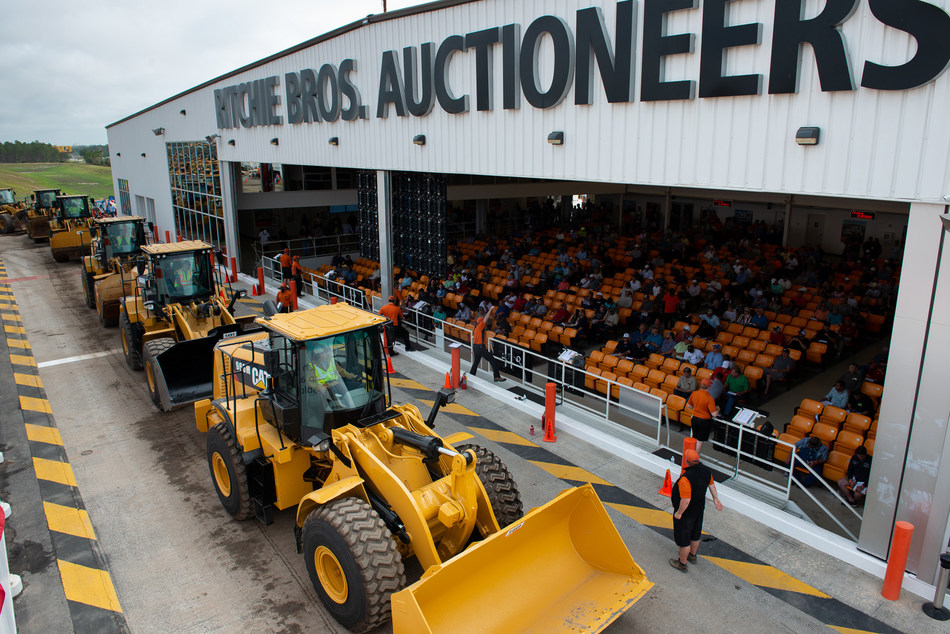 More than 430 loaders were sold in Ritchie Bros.' record-breaking Orlando, FL auction last week. (CNW Group/Ritchie Bros. Auctioneers)