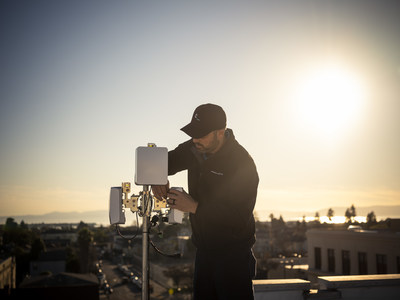 Common Networks Field Technician Installs Terragraph on a Roof in San Francisco Bay Area. Credit: Facebook