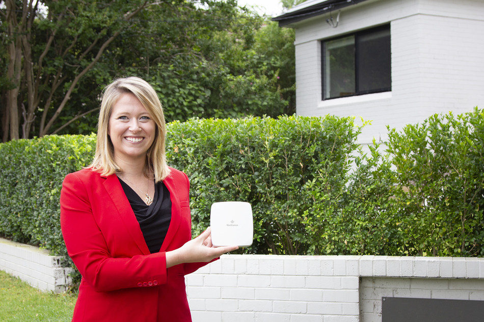 Els Baert, Director of Marketing & Communications at NetComm, pictured with one of NetComm's 5G Self-Install antennae.