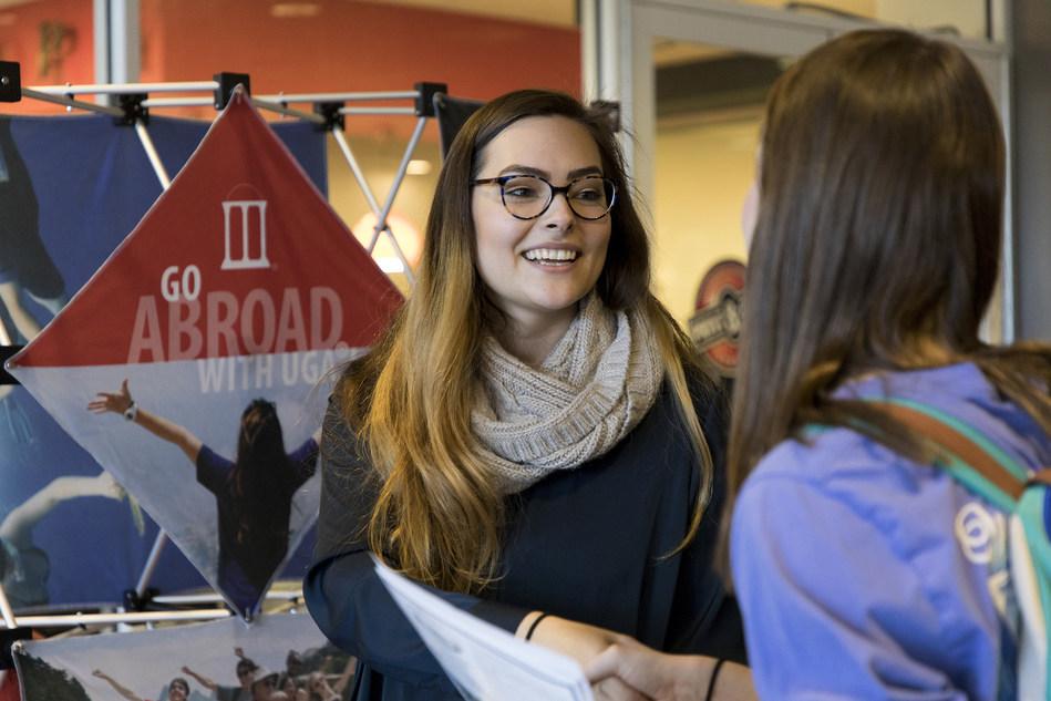 UGA education abroad adviser Kaija Lazda, left, talks with undergraduate student Sarah Farmington at an Office of International Education booth at the Study Abroad Fair.