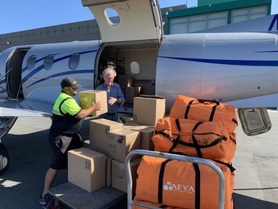 Jan Soderberg loads his private plane with aid supplies bound for Puerto Rico.