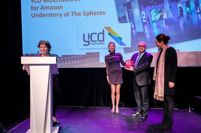 Sam Losar, YCD CEO and Revital Alcalay, YCD VP of Marketing accepting the Digital Signage Award at Digital Signage Award gala event in Amsterdam (PRNewsfoto/YCD Multimedia)