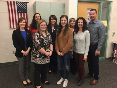 Taylor Brown, center, celebrates Lights, Camera, Save! third-place win with parents, Central Dauphin business teacher, and Centric Bank team.