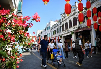 Tourists visit Qilou ancient street in Haikou, capital of south China's Hainan Province, on Feb. 6, 2019, the second day of the Chinese Lunar New Year.