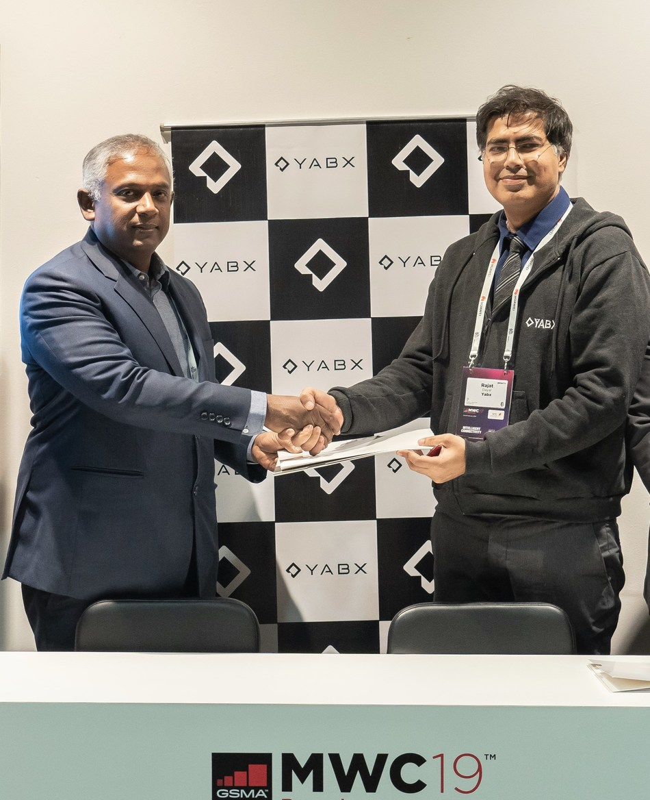 Mahtab Uddin Ahmed, MD & CEO, Robi and Rajat Dayal, Founder & CEO, YABX sign MoU at MWC (PRNewsfoto/Comviva)