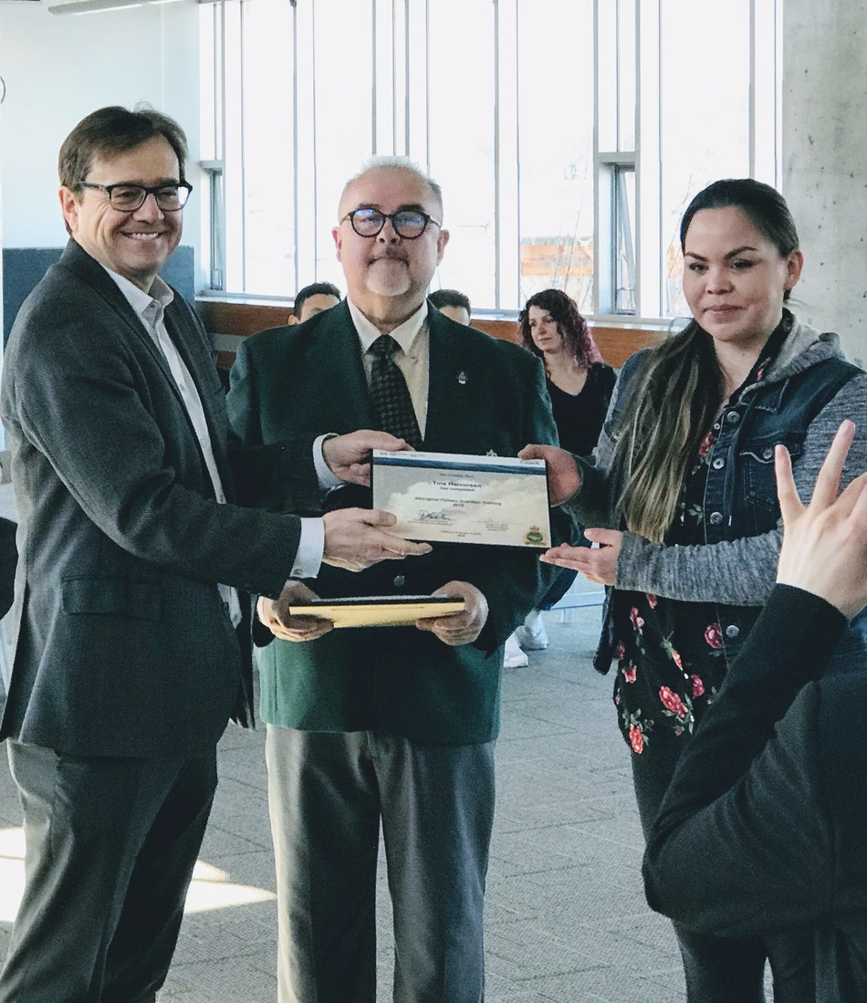 (Left to Right) Minister Wilkinson, Dave Loop C&P Course Coordinator present  Tina Halvorsen of the Uchucklesaht Tribe with her certificate. (CNW Group/Fisheries and Oceans Canada, Pacific Region)