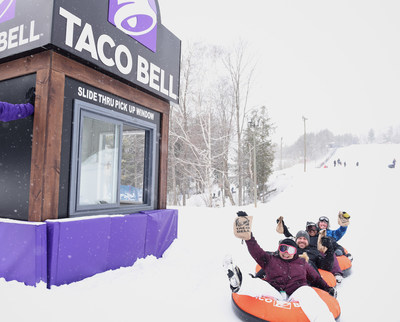 "Taco Bell fans will test the world's first ""slide-thru"" takeout window - ordering Taco Bell at the top of a snow tubing hill and collecting it at the bottom (CNW Group/Taco Bell Canada)"