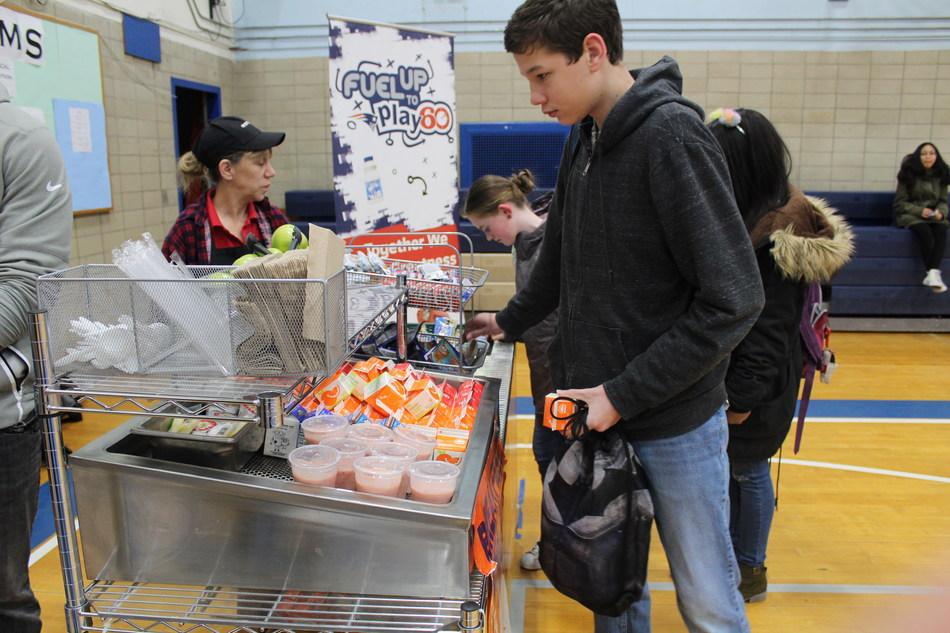 Student grabbing breakfast from mobile cart