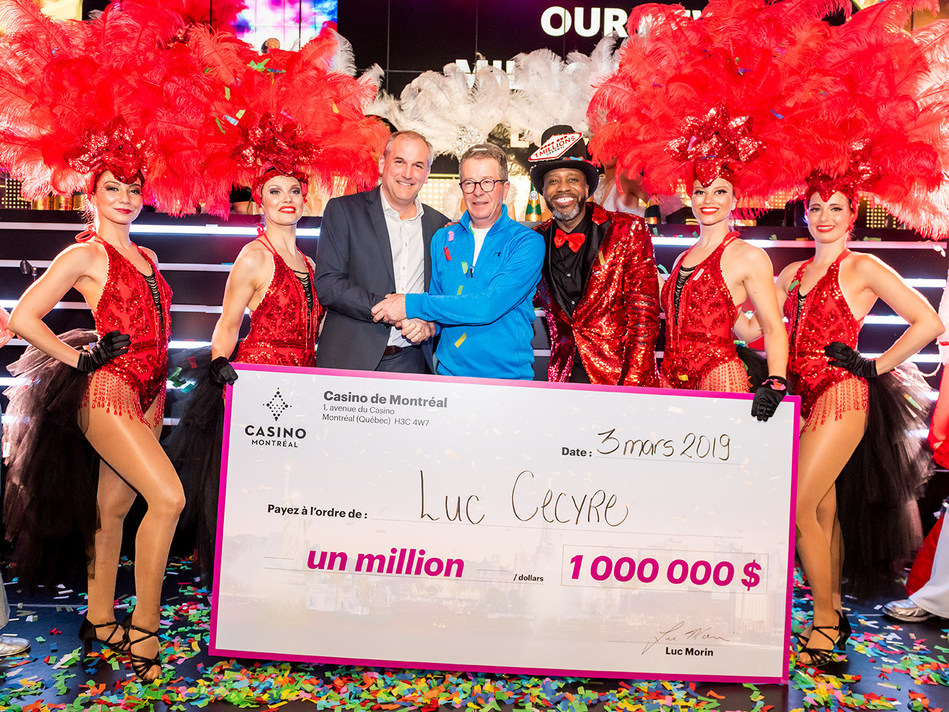 Mr. Luc Cecyre, new millionnaire, poses with Mr. Luc Morin, General Manager of the Montreal Casino, along with the Casino animation team. Credit : Marie-Soleil Cloutier (CNW Group/Société des casinos du Québec)