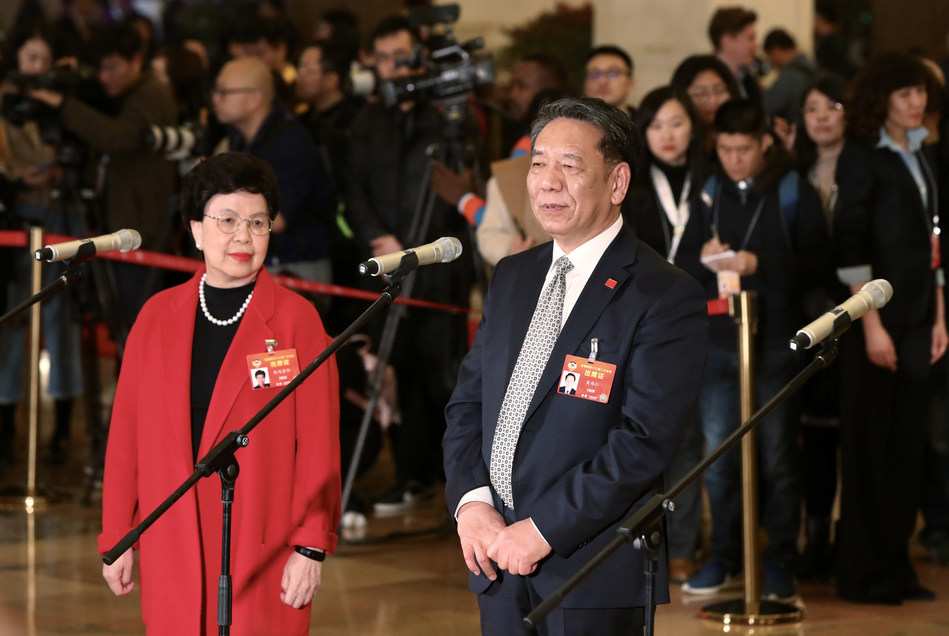 Margaret Chan and Wu Weiren, members of the 13th CPPCC National Committee, receive interview ahead of the annual session's opening in Beijing on Sunday. Photo by Zhu Xingxin China Daily.