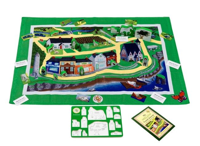 World Village Playset Ireland includes play mat, wooden figures, story and activity book and story cards.