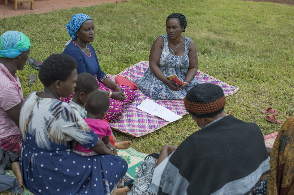 Anna-Mary Buzige (center) is mentoring women in her village as part of CARE's She Feeds the World program. The PepsiCo Foundation's $18.2 million investment in the program will support financial and agricultural trainings for women farmers around the world. Photo by Josh Estey/CARE