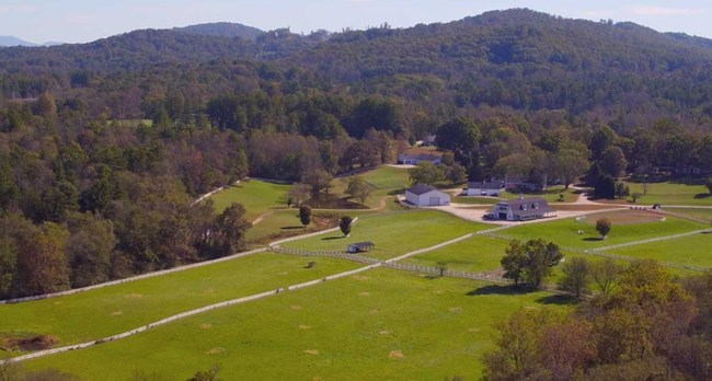 Nestled in the highlands of the Blue Ridge Mountains on the tail end of the French Broad River, sits The Horse Shoe Farm, an 85-acre riverfront estate, minutes from downtown Hendersonville, Asheville, and Tryon, NC.