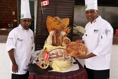 Chef Mendis (left) and Chef Thalagala show off six breads made in just four hours. (CNW Group/Sodexo Canada)