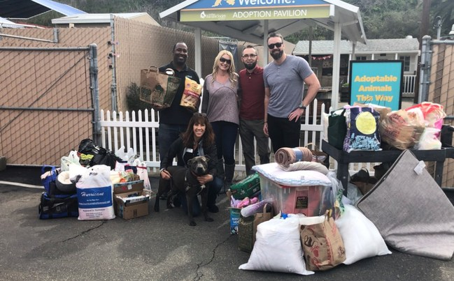 Monterey Financial and San Diego Humane Society employees shown with some of the items recently collected as part of an employee donation drive.