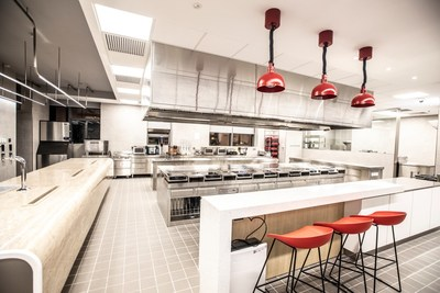 The test kitchen features state-of-the-art equipment and open communal areas