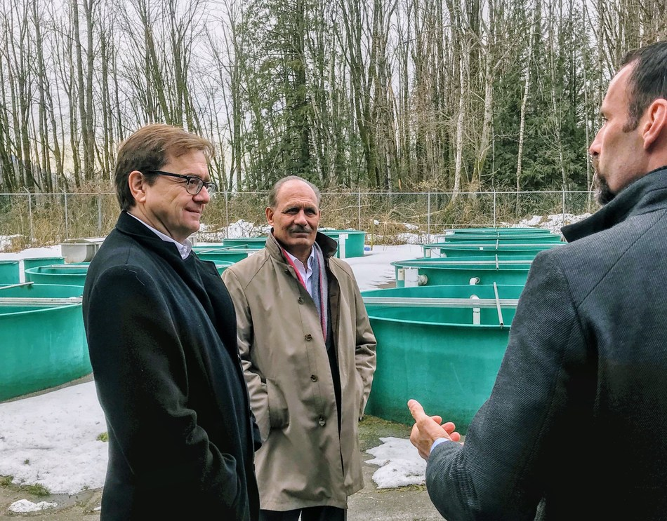 (Left to Right) Minister Wilkinson and MP Jati Sidhu (Mission-Matsqui-Fraser Canyon) with Corino Salomi, DFO Regional Manager, Enhancement Operations, at the Sockeye facility at Inch Creek Hatchery. (CNW Group/Fisheries and Oceans Canada, Pacific Region)