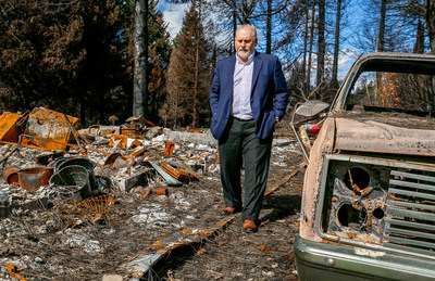 Richard Thorp, MD, president of Paradise Medical Group walks next to his burned down home in Paradise, Calif. on February 28th, 2019