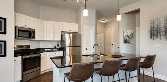 The Metcalf Village Apartments, now operating as the Boulders at Overland Park Apartments, feature well-appointed kitchens with high end finishes and brand new stainless steel appliances