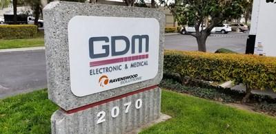 GDM signage proudly displays Ravenswood logo reflecting strategic partnership.