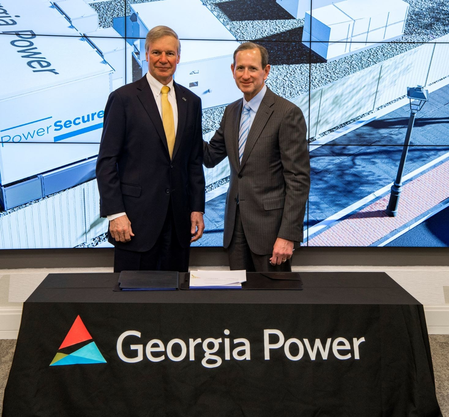 """Georgia Tech President G. P. """"Bud"""" Peterson and Chairman, President and CEO for Georgia Power Paul Bowers at Georgia Power Microgrid for Tech Square MOU Signing Ceremony"""