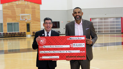 Grant Hill, Hawks Vice Chair of the Board and Naismith Memorial Basketball Hall of Famer presenting donation to Prostate Cancer representative, Seth Swerdlow, Director of Corporate Development