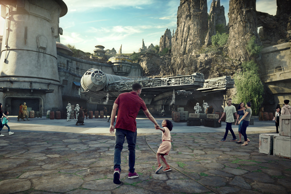 Star Wars: Galaxy's Edge will open May 31, 2019, at Disneyland Park in Anaheim, California, and August 29, 2019, at Disney's Hollywood Studios in Lake Buena Vista, Florida. At 14 acres each, Star Wars: Galaxy's Edge will be Disney's largest single-themed land expansions ever, transporting guests to live their own Star Wars adventures in Black Spire Outpost, a village on the remote planet of Batuu, full of unique sights, sounds, smells and tastes. Guests can become part of the story as they sample galactic food and beverages, explore an intriguing collection of merchant shops and take the controls of the most famous ship in the galaxy aboard Millennium Falcon: Smugglers Run. (Disney Parks)