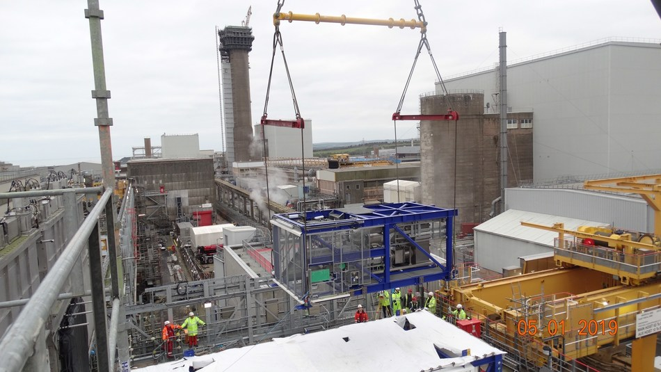 A crane lifts the waste retrieval system into place at the Pile Fuel Cladding Silo, Sellafield site in England. Credit: Bechtel Cavendish Nuclear Solutions