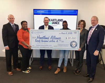 Combined Insurance leaders Bob Wiedower, Doug Abercrombie, and Israel Stacy presented a $20,000 check to Heartland Alliance.