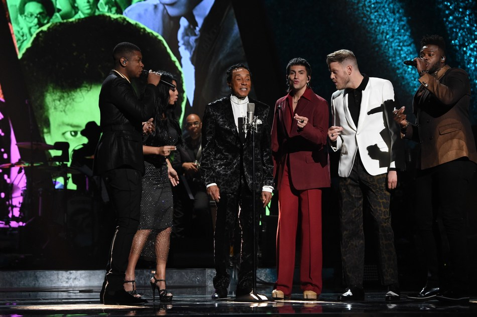 """Smokey Robinson (3rd L) performs with (from L) Matt Sallee, Kirstin Maldonado, Mitch Grassi, Scott Hoying, and Kevin Olusola of Pentatonix onstage during """"Motown 60: A  GRAMMY® Celebration."""" International distribution handled by Alfred Haber, Inc. (Photo by Kevin Mazur/Getty Images for NARAS)"""