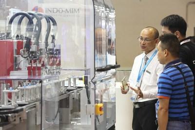 Visitors viewing automation equipment at Medtec China 2018