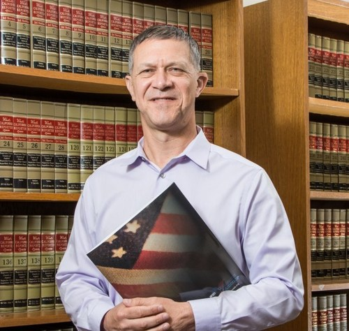 """Dwight Stirling is the founder & CEO of the Center for Law and Military Policy (CLMP), a nonprofit think tank working to restore and protect legal rights for active duty service members and veterans. He is a USC Professor and a JAG Officer in the California Army National Guard. Stirling was the founding chair of the Orange County Bar Association's Veterans and Military Committee and was recognized in 2016 as Orange County's """"most influential"""" for his co-founding of the Veterans Legal Institute."""