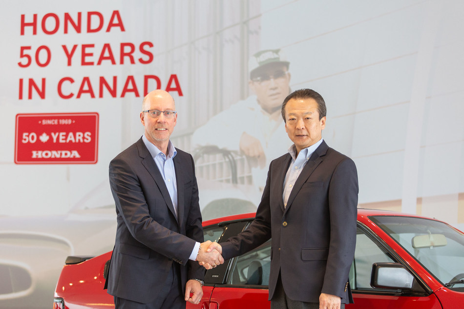 Honda Canada associates and special guests, including Toshiaki Mikoshiba, Chairman and CEO of Honda North America, Inc. (right) and Dave Gardner, President and CEO of Honda Canada Inc., celebrated 50 years of growth and success in Canada during a commemorative ceremony at the company's head office near Toronto. (CNW Group/Honda Canada Inc.)