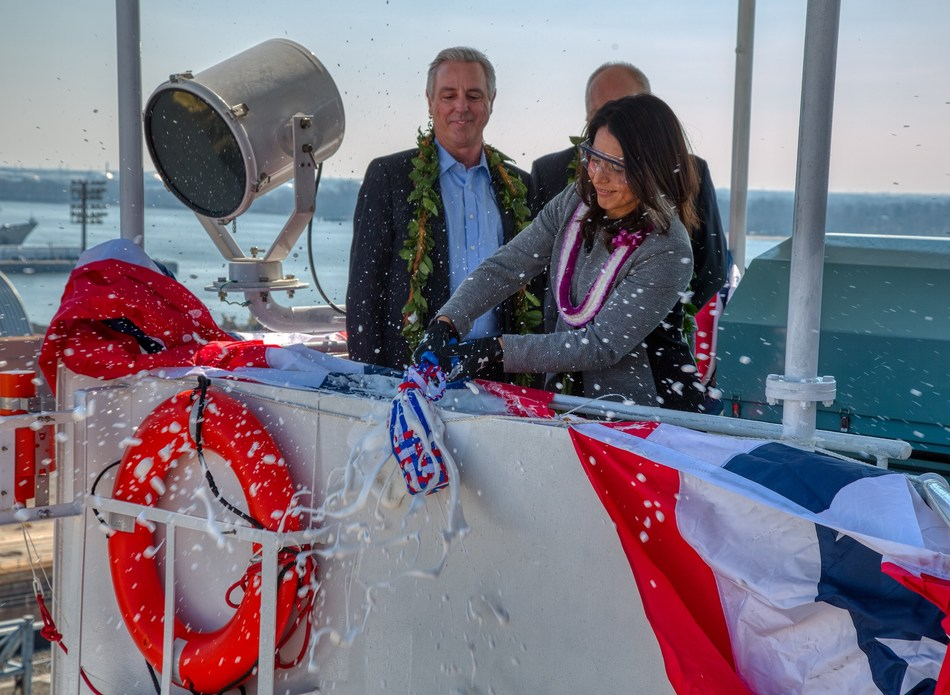 U.S. Congresswoman Tulsi Gabbard of Hawaii breaks a ceremonial bottle of champagne to christen Matson's new containership, 'Kaimana Hila.'